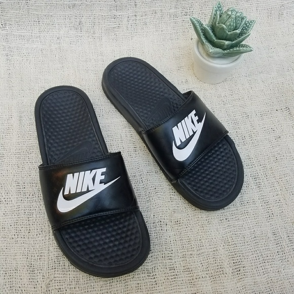 a2e6f274cae0 Nike Classic Black and White Swoosh Slides. M 5a78045ba44dbe5b4b897537.  Other Shoes you may like. Red and black sandals